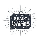 """Hand drawn textured vintage label, retro badge with suitcase vector illustration and """"Ready for new adventures"""" lettering."""