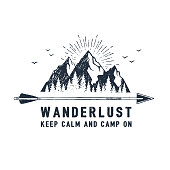 "Hand drawn travel badge with mountains textured vector illustration and "" Wanderlust. Keep calm and camp on"" inspirational lettering."