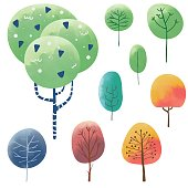 Vector illustration of a set of colorful hand drawn trees with a texture effect.