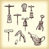 Vintage corkscrew on an old wooden table background with space for text, horizontal photo