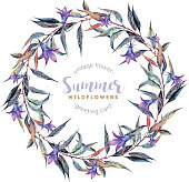 Hand drawn watercolor wildflower wreath with bells and willow leaves isolated on white background. Realistic illustration in trendy vintage style.
