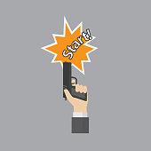 Hand firing a gun for starting race with start text