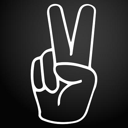 Hand gesture victory symbol on a dark background