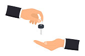 Hand giving house keys to customer. Businessman in suit giving house key. Mortgage, credit or property concept. Sale and rent of apartment. Buying a house. Sale and purchase concept