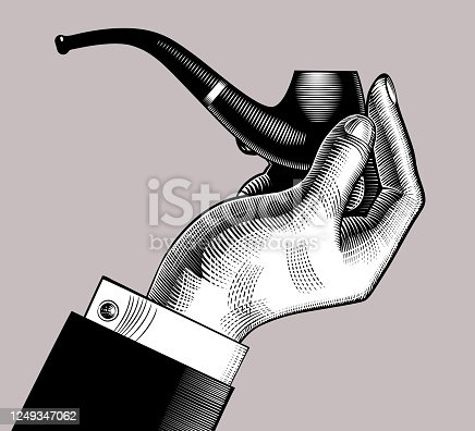 istock Hand holding a classic tobacco pipe 1249347062
