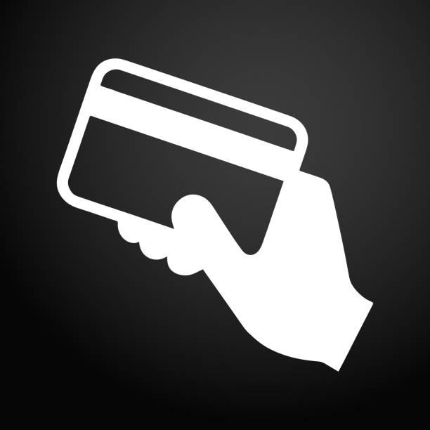 ilustrações de stock, clip art, desenhos animados e ícones de hand holding a credit card icon - paying with card