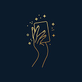 Hand holding a magical card vector line art on black background