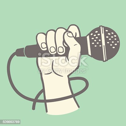 istock Hand Holding a Microphone 526663769
