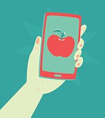 Hand Holding a Phone with an Apple Inside