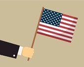 Hand holding American flag. Vector.