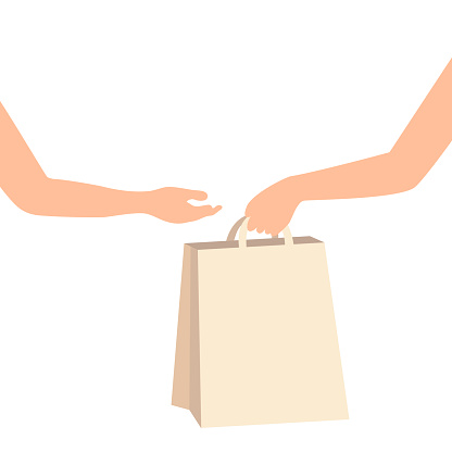 Hand holding and giving paper bag to other hand. Customer receiving shopping bag from courier, volunteer, social woker. Donation delivery service. Senior care. Hand to hand assistance.