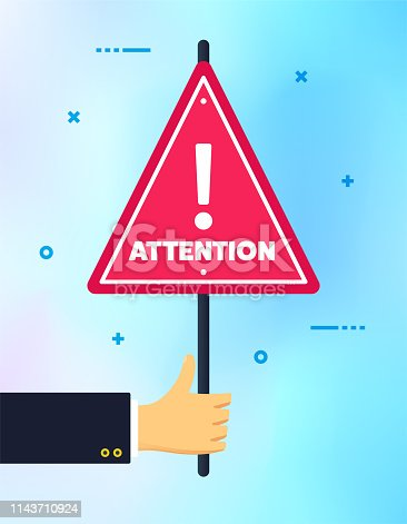 istock Hand Holding Attention Please Banner Sign 1143710924