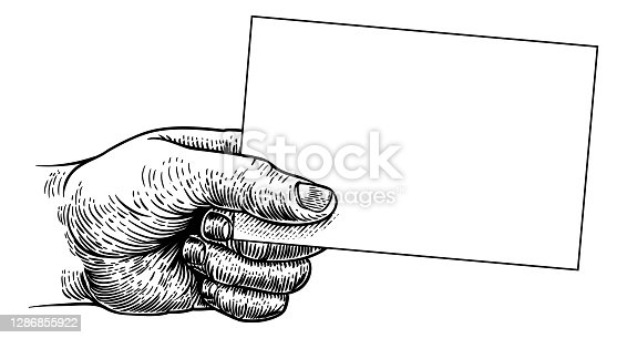 istock Hand Holding Business Card Flyer Note Frame Sign 1286855922