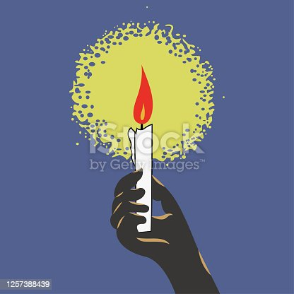 istock Hand holding candle 1257388439