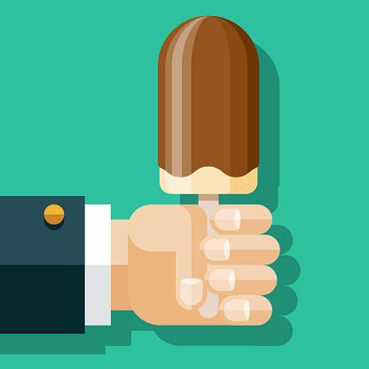 Hand Holding Chocolate Dipped Ice Cream