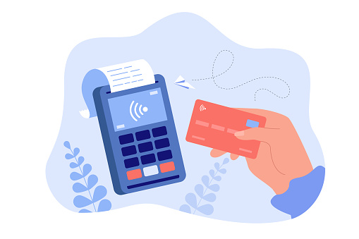 Hand holding debit or credit card for payment