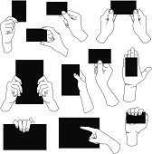 A set of hands holding paper in a different direction and styles.