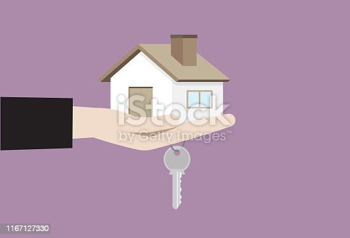 istock Hand holding house and house key 1167127330