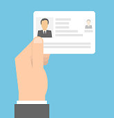 istock Hand holding id card 1177995371