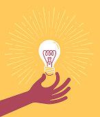 istock Hand holding Lightbulb 1124529223