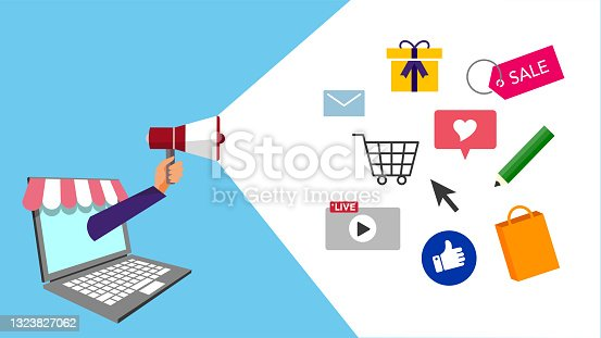 istock hand holding megaphone in PC,marketing image,text space,vector illustration,bluebackground 1323827062