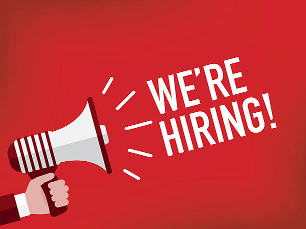 Hand holding megaphone with we're hiring announcement Hand holding megaphone with we're hiring announcement help wanted sign stock illustrations