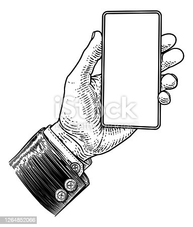 istock Hand Holding Mobile Phone Vintage Style 1264852066
