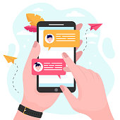 istock Hand holding mobile phone with online messages 1248699525
