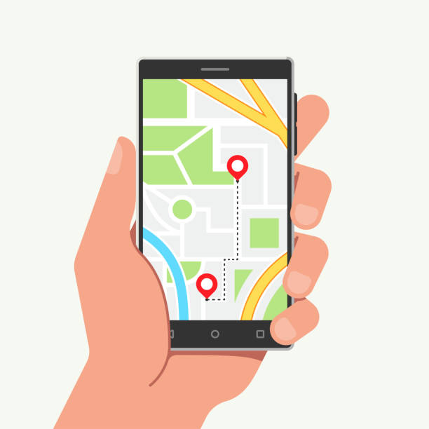 hand holding phone with map and mobile navigation in flat style. vector illustration - hand holding phone stock illustrations