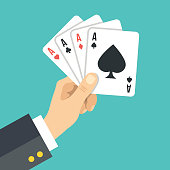 Hand holding playing cards. Four aces. Poker, casino, gambling concepts. Flat design vector illustration