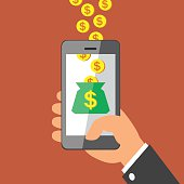 Hand holding smart phone and Earning Money Coins