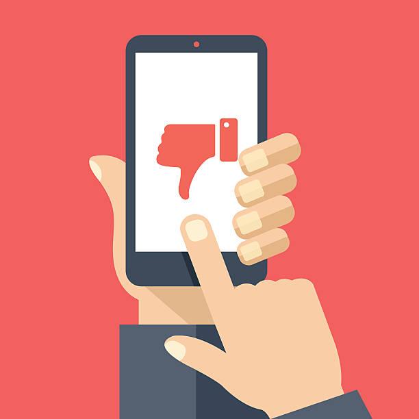 ilustrações de stock, clip art, desenhos animados e ícones de hand holding smartphone, dislike on screen. flat design vector illustration - furioso