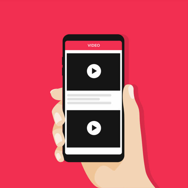 Hand holding Smartphone or Mobile phone with video channel on the screen. Movie app concept. Hand holding Smartphone or Mobile phone with video channel on the screen. Movie app concept. Vector hand holding phone stock illustrations