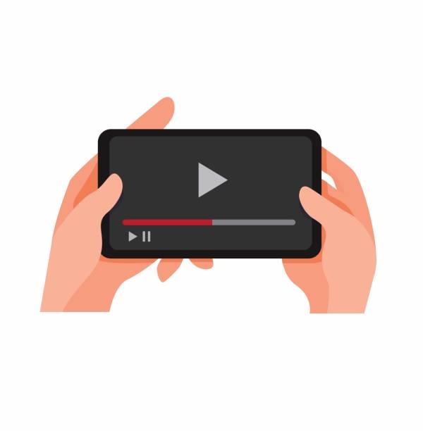 hand halten smartphone sehen video-streaming online, video-media-player auf handy cartoon flache illustration vektor isoliert in weißem hintergrund - zusehen stock-grafiken, -clipart, -cartoons und -symbole