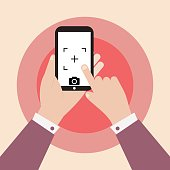 hand holding smartphone with camera icon vector illustration