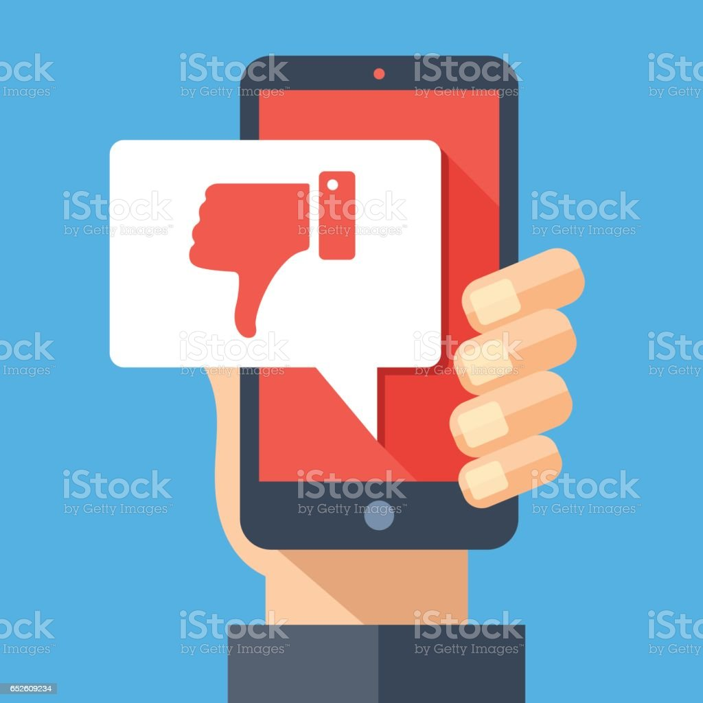 Hand holding smartphone with dislike message, dislike button. Thumbs down icon. Social networking, social media usage on mobile device. Flat design vector illustration vector art illustration
