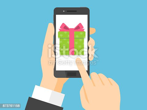 istock Hand holding smartphone with gift box on the screen 873761158