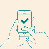 Hand holding smartphone with green check mark. Vector illustration in flat line styleHand holding smartphone with green check mark. Vector illustration in flat line style