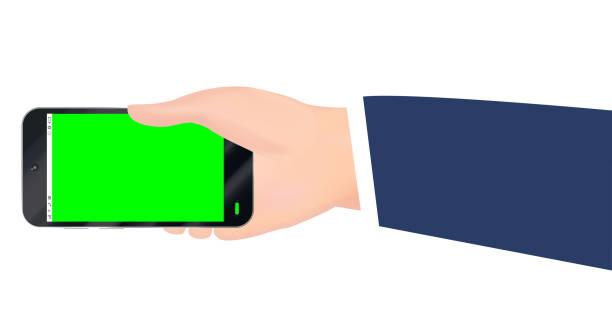 stockillustraties, clipart, cartoons en iconen met hand met smartphone met groen scherm vector - green screen