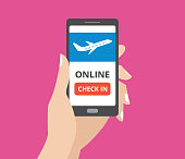 Hand holding smartphone with online check in button and airplane icon on screen. Concept of mobile application.