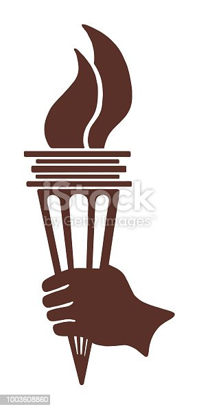 istock Hand Holding Torch 1003608860