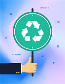 Hand holding waste recycling vintage rough street or banner sign on colorful background. Can be used for web banners and infographic design.
