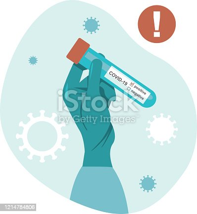 istock Hand holds a test tube containing a positive test sample for COVID-19 1214784806