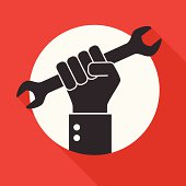 Hand holds a wrench, Repair icon on red background.