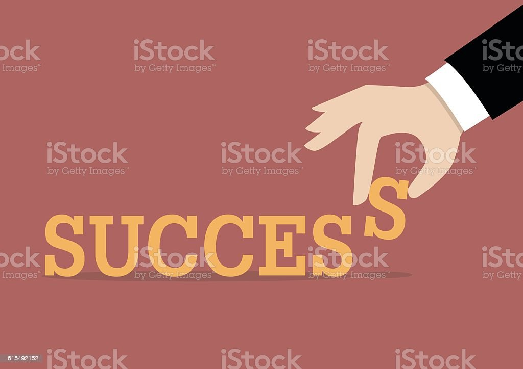 Hand inserts the last alphabet into success word