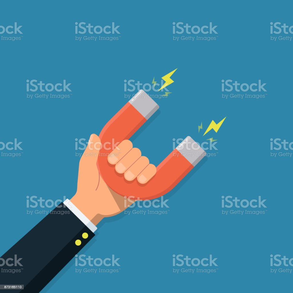 Hand of a businessman with magnet. Business concept of the attraction of money, customers and investment. vector art illustration
