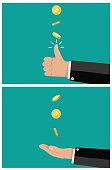 hand of businessman tossing and catches a coin