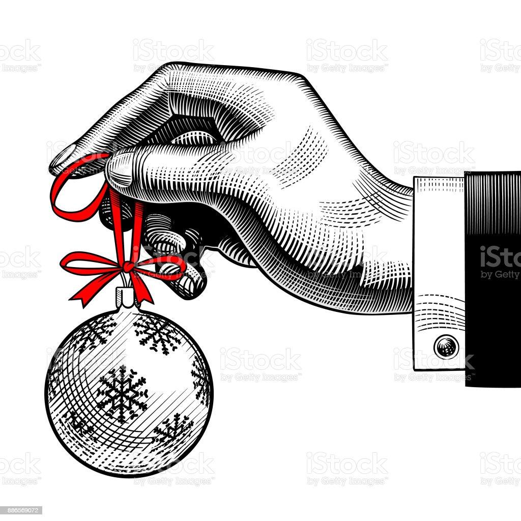 Hand of man holding a Christmas tree ball vector art illustration