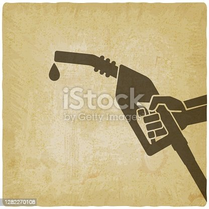 Hand with gasoline fuel nozzle on vintage background. Vector illustration