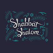 "Hand written lettering with text ""Shabbat shalom""."